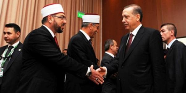 https://prodromikos.files.wordpress.com/2016/10/5a3f0-mete-erdogan-athens-660x330.jpg?w=602&h=301